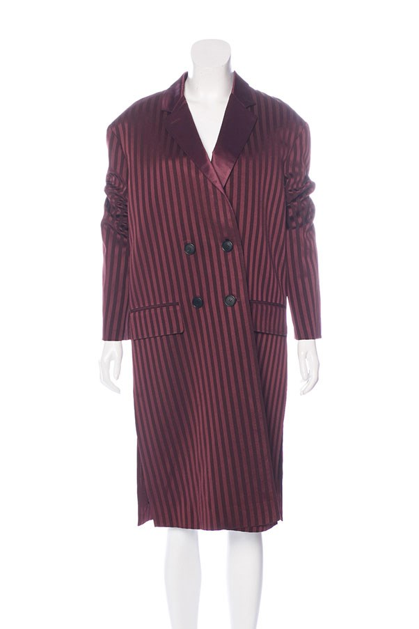 "Coat by Givenchy, $975 at <a href=""https://www.therealreal.com/products/women/clothing/coats/givenchy-double-breasted-striped-coat-w-slash-tags>The Real Real</a>."