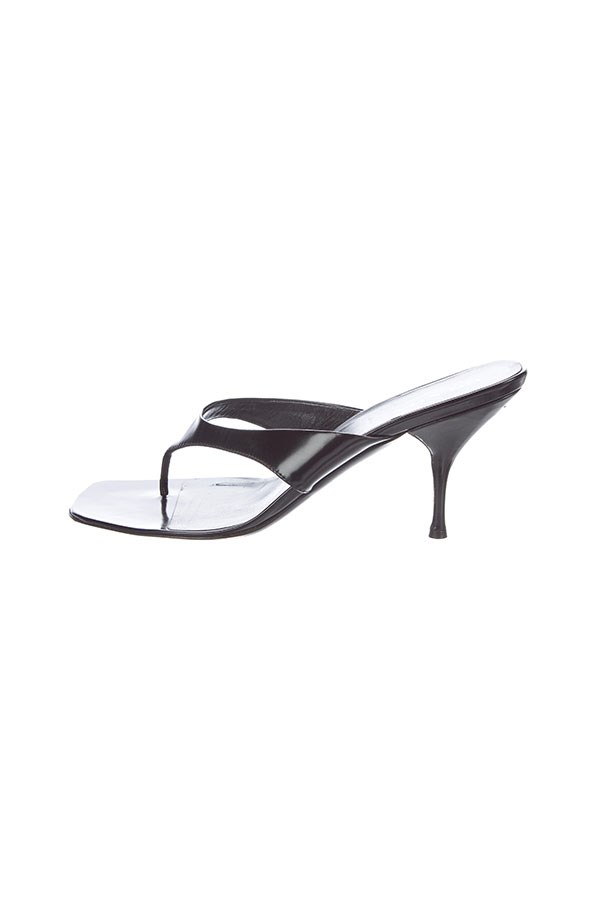 "Sandals by Prada, $201 at <a href=""https://www.therealreal.com/products/women/shoes/sandals/prada-patent-leather-slide-sandals-84"">The Real Real</a>."