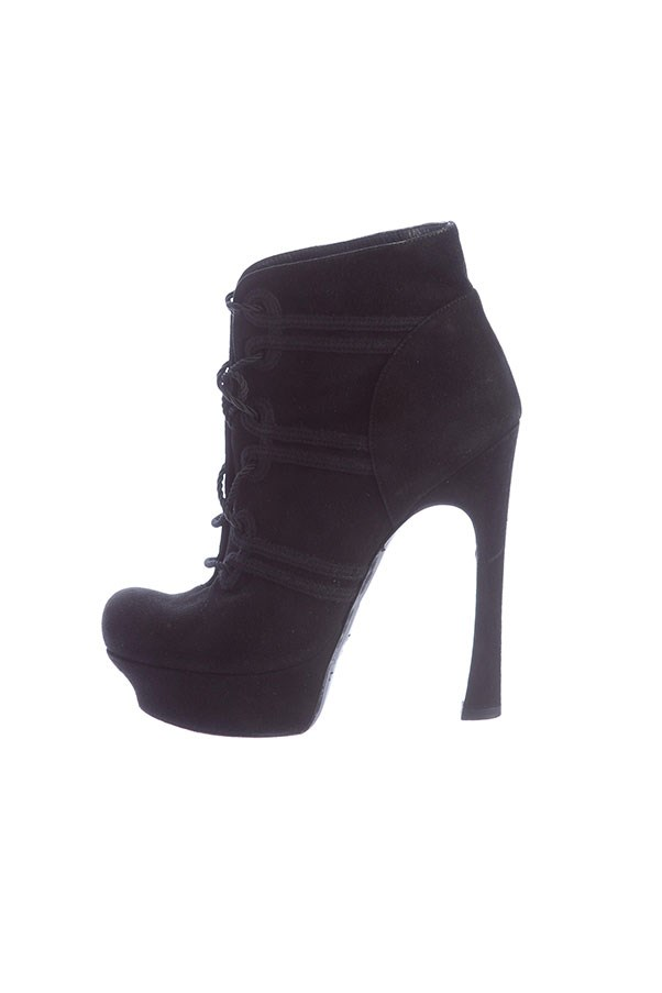 "Booties by Yves Saint Laurent, $470 at <a href=""https://www.therealreal.com/products/women/shoes/boots/yves-saint-laurent-lace-up-platform-booties-9"">The Real Real</a>."