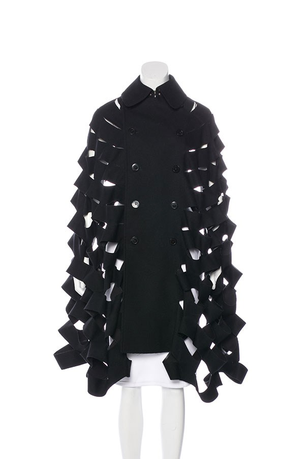 "Cape by Junya Wanatabe Comme des Garçons, $1,244 at <a href=""https://www.therealreal.com/products/women/clothing/coats/junya-watanabe-comme-des-garcons-double-breasted-cutout-cape"">The Real Real</a>."