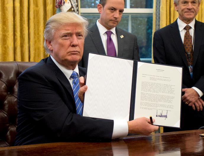 <p>Many photos of Trump have been of him signing executive orders.