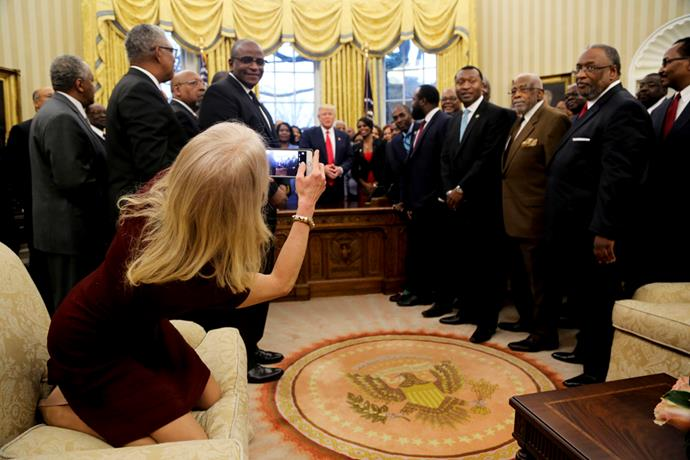 <p>Kellyanne Conway, Counselor to the President, was deemed to be sitting in the Oval Office inappropriately when she took this photo of Donald Trump.