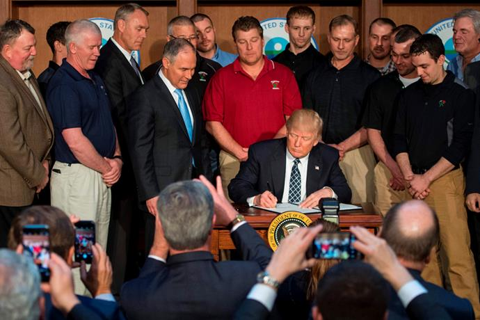 <p>Every time Donald Trump signs something, he needs to be surrounded by men, apparently.