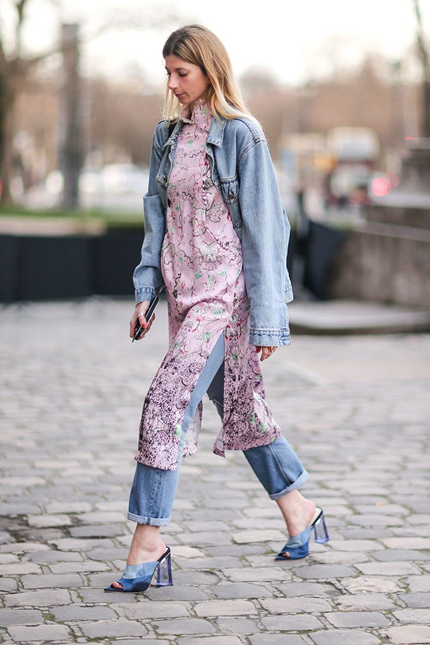 <p><strong>3. Wear a girly dress over jeans</strong>