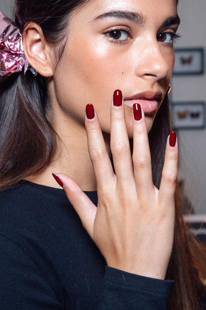 """<p><strong>Kate Spade</strong> <br><br> <p>For this deep rouge nail look, Deborah Lippmann contoured natural nails into a short, rounded shape and applied one coat of the black cherry hue, Cherries Jubilee. Once dry, she layered the colour with <a href=""""https://www.adorebeauty.com.au/deborah-lippmann/deborah-lippmann-nail-lacquer-lady-is-a-tramp.html"""">Lady is a Tramp</a>."""