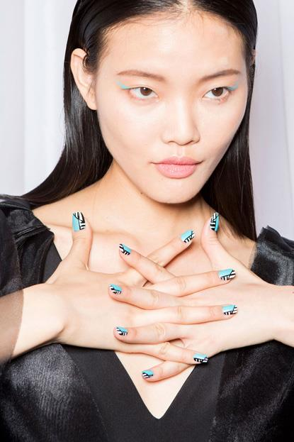 """<p><strong>Christian Siriano </strong> <br><br> <p>Manicurist <a href=""""https://www.instagram.com/ginaedwards_/?hl=en"""">Gina Edwards</a> gave the models a graphic teal, black and white nail by Kiss Products."""