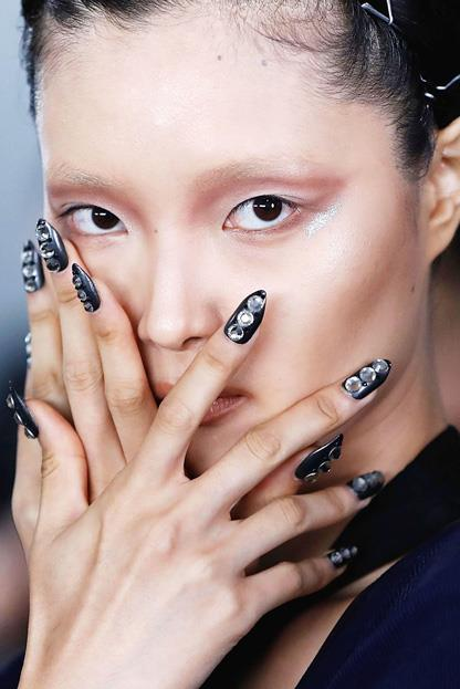 """<p><strong>The Blonds</strong> <br><br> <p>The Blonds celebrated their 10th year anniversary this season with a futuristic metallic collection that extended to their nail look. Morgan Taylor lead nail artist <a href=""""https://www.instagram.com/ciaomanhattan2012/?hl=en"""">Mei Kawajiri</a> chose a chromatic colour scheme and embellished the look with crystals, sequins, and more."""