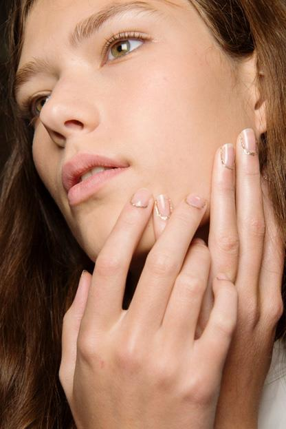 """<p><strong>Rodarte</strong> <br><br> <p><a href=""""http://www.morgantaylorlacquer.com/"""">Morgan Taylor Lacquer</a> lead artist Tracylee accessorised the nails with """"cuticle jewellery"""" that resembled gold chains, mimicking the collection. Start with a clear base, then use a thin brush to apply a glittery gold around the edge of the cuticle."""