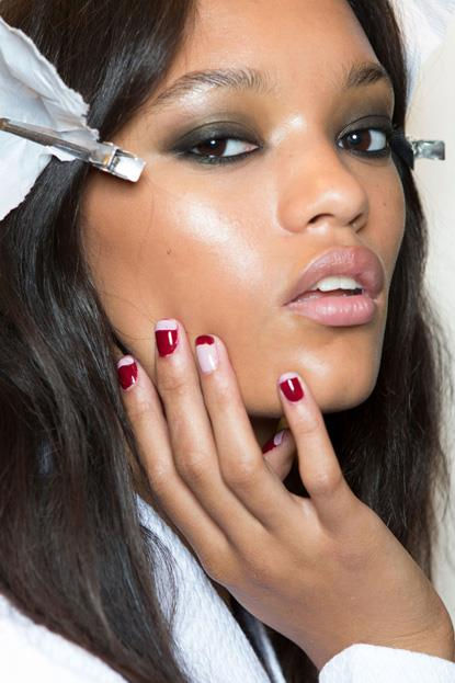 """<p><strong>Rebecca Minkoff</strong> <br><br> <p>Rebecca Minkoff nails by <a href=""""http://www.essie.com.au/"""">Essie </a>were done in alternating halves of cherry red and pale nude that, like their collection, is available to purchase immediately."""