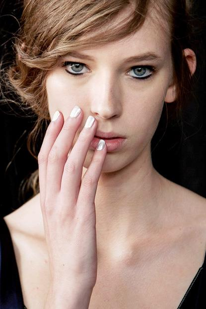 """<p><strong>3.1 Phillip Lim</strong> <br><br> <p>Inspired by silver accents in the collection, <a href=""""https://au.sallyhansen.com/"""">Sally Hansen</a>'s Madeline Poole created a distressed metallic look by brushing a silver polish over white."""