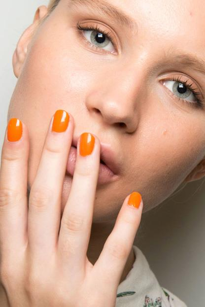 """<p><strong>Tibi</strong> <br><br> <p><a href=""""http://jinsoon.com/"""">Jin Soon Choi </a>opted for a simple look, painting the models' nails in a single shades ranging from tangerine orange to toffee."""