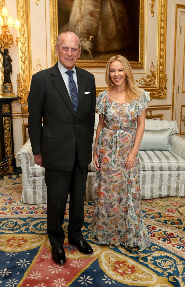 <p>Kylie Minogue meeting Prince Philip in 2017.