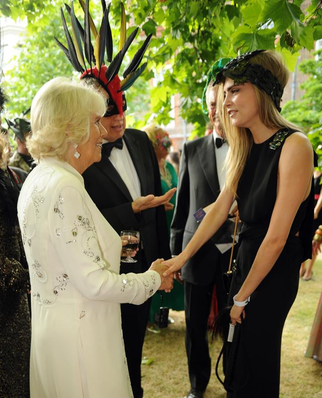 <p>Cara Delevingne meeting Camilla, Duchess of Cornwall, and Prince Charles in 2013.