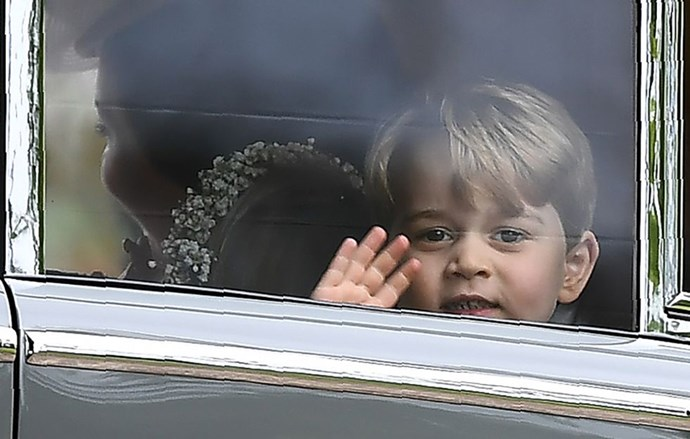 **When George couldn't help but wave hello**<br> En route to the ceremony, George waved at photographers and passersby and gifted us all with this adorable shot and a sweet smile.