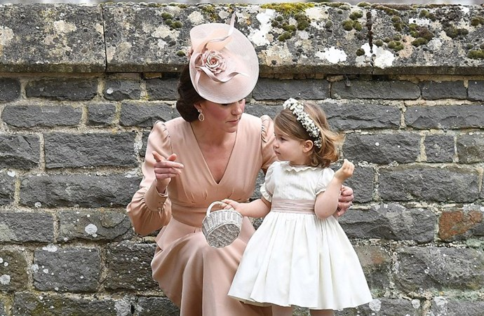 **Charlotte getting some bridesmaid advice from her mum**<br> Noted as being nervous about how her children would handle the crowds and behave at the ceremony, Kate was every bit the super mum before and after the ceremony.