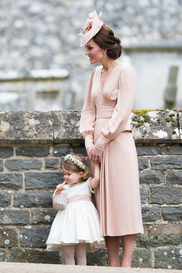 **Charlotte holding hands with her mother**<br> The youngest bridesmaid in the bunch, Charlotte stayed close to Kate before the ceremony.