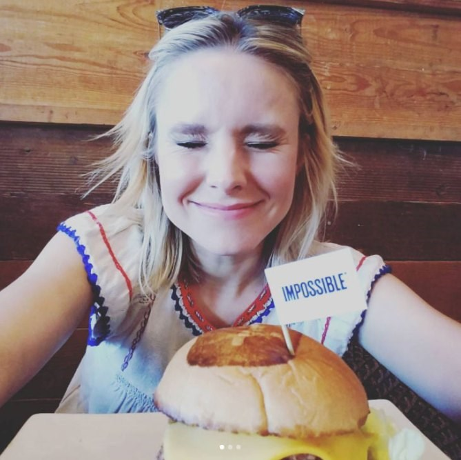**Kristen Bell**<br><br> Kristen Bell is doing what anyone would on a public holiday—eating.