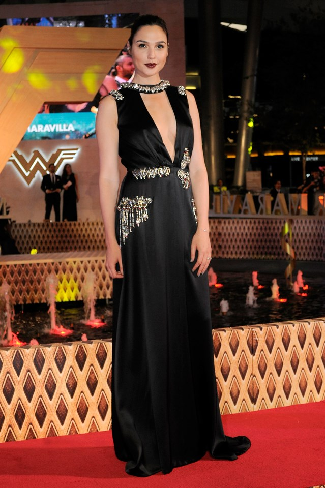 <p>You might not be able to tell from this photo, but real life Wonder Woman Gal Gadot is actually wearing flat sandals underneath this dress. How do we know? Her stylist let slip on Instagram.