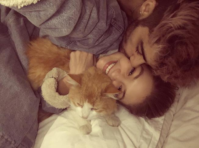 """Zayn was there for Gigi during one of her toughest moments—when she lost her cat, Chub. """":( we love you always chub 👼🏼🐈,"""" she captioned this Instagram of the three of them."""
