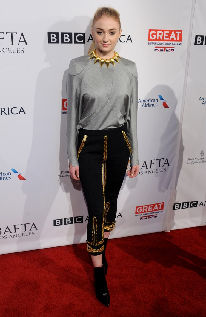 In a silver shirt and gold accessories at the BAFTA tea party, 2017.
