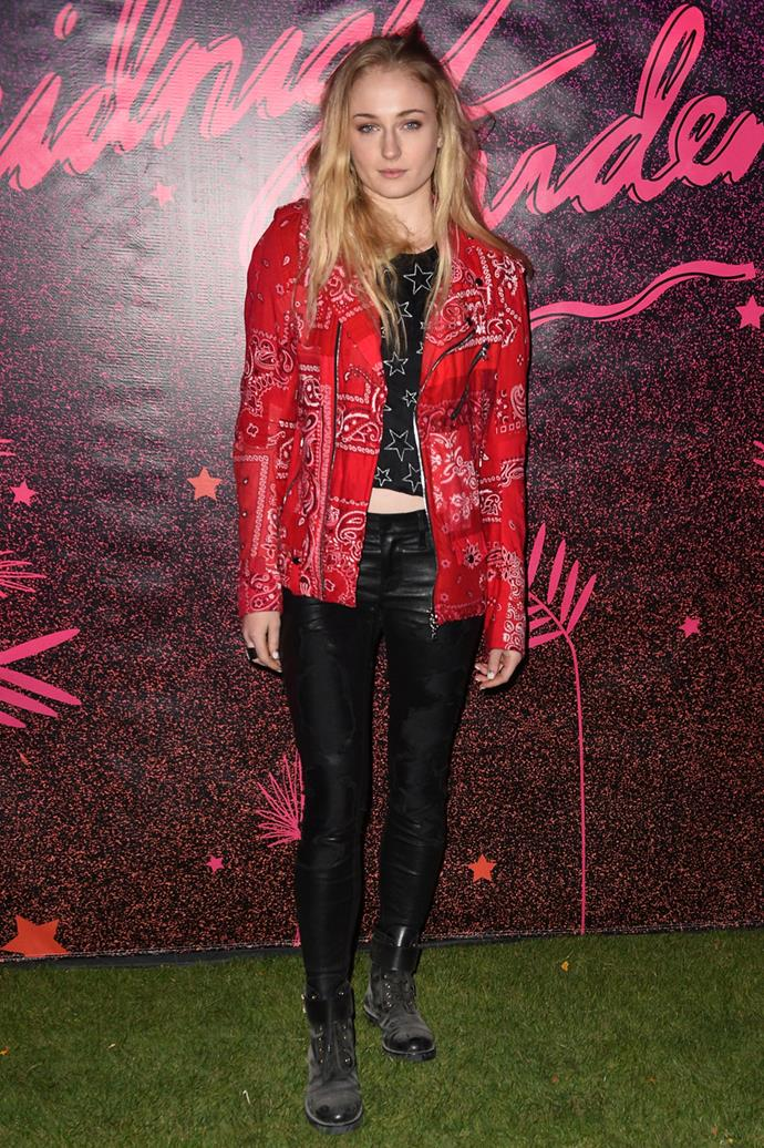 In a red jacket and leather pants at the Midnight Garden After Dark at the NYLON Estate.