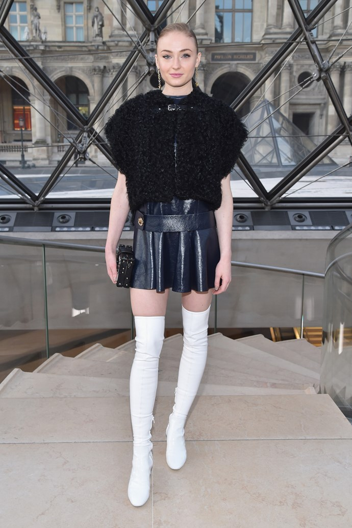 In a Louis Vuitton vest and skirt at the brand's Paris Fashion Week show.