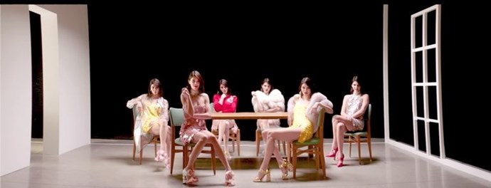 "And sitting at a table with five more of herself. They appear on and off.    ***Via:*** [***ELLE US***](http://www.elle.com/culture/music/a12450765/kendall-jenner-lip-syncing-in-fergies-enchante-video/|target=""_blank""