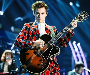 Harry Styles' Gucci Boots Have Their Own Assistant On Tour