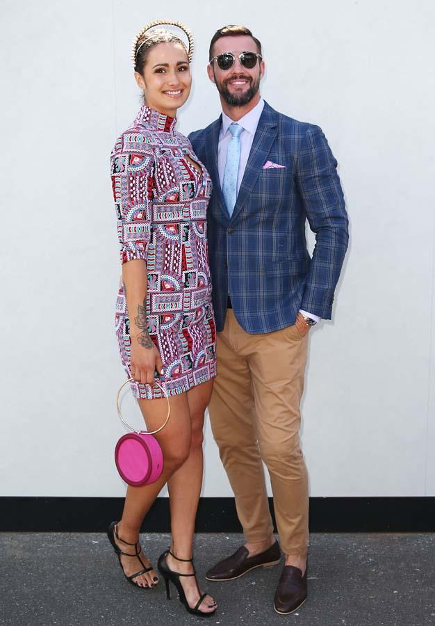 Kris Smith and Sarah Boulazeris pose at the Myer Marquee on Stakes Day.