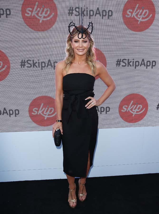 Natalie Bassingthwaighte poses at the Sensis Marquee on Stakes Day.