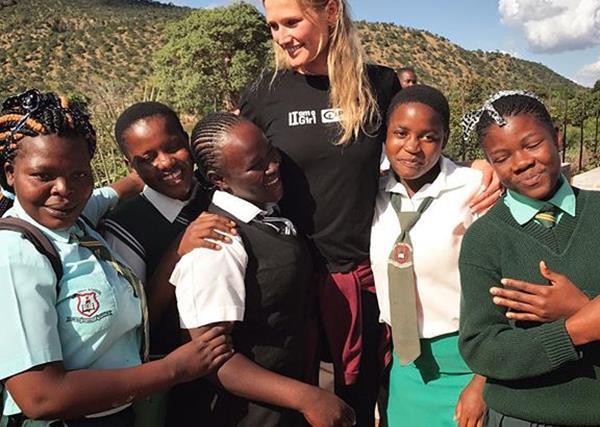 Toni Garrn with the Zimbabwean girls she is helping through the Toni Garrn Foundation and Plan International