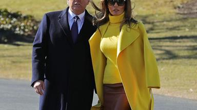 Watch Melania Trump Use Her Fabulous Coat To Swerve Holding Donald Trump's Tiny Hand