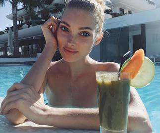 Reece Witherspoon drinking a green juice