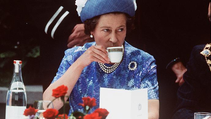 Queen Elizabeth drinking tea.
