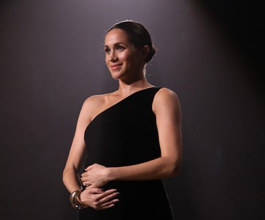 Meghan Markle Cradles Her Baby Bump At The British Fashion Awards