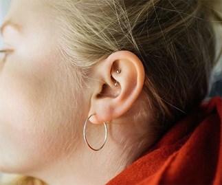 Rook ear piercing.