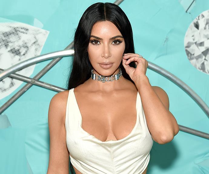 Kim Kardashian attends a Tiffany & Co. party wearing a white dress.