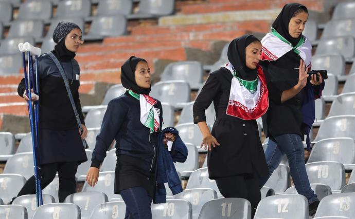 Iranian women in a football stadium.