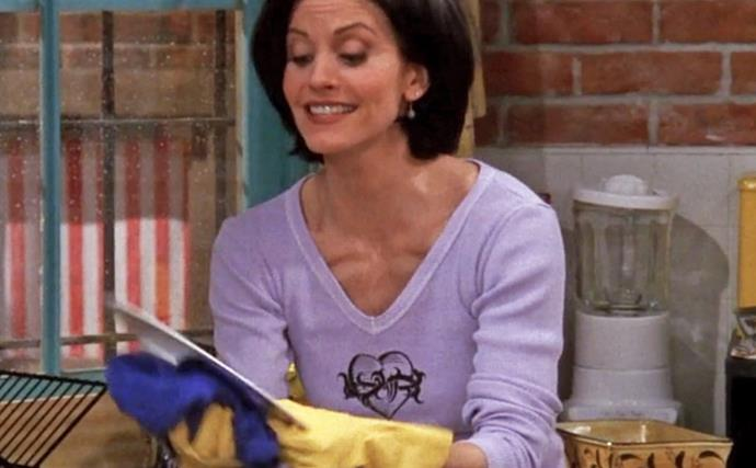 Monica from 'Friends' doing the dishes.