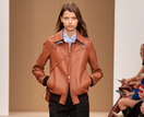 Tod's Mixes Timeless Leather With Cult '90s Accessories At Fashion Week
