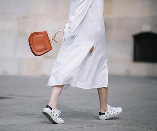 White sneakers and skirt street style.