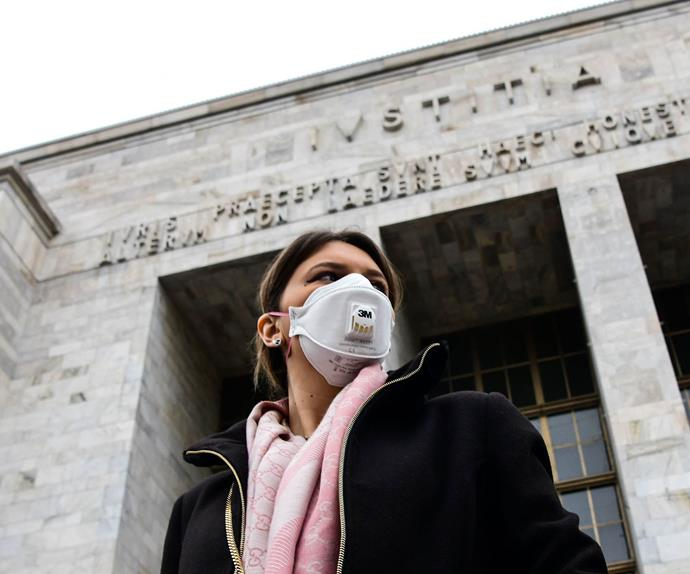 Woman wearing a mask in Italy during a COVID-19 lockdown.