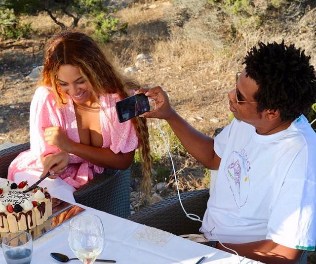 Jay-Z Taking Photo Of Beyoncé Knowles Cutting Cake