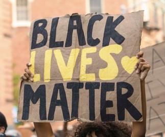 black lives matter sign at a protest