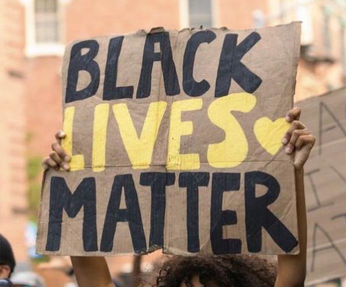 black lives matter sign at a protest