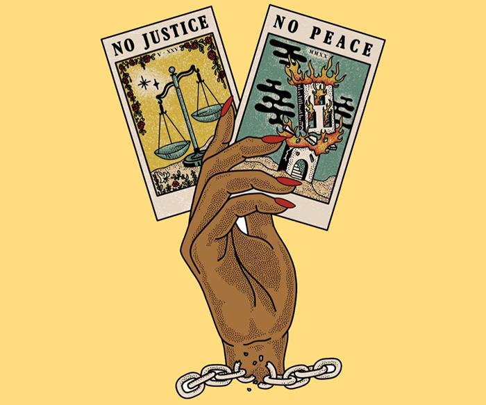 A black hand with red nails holding two tarot cards that say no justice no peace.