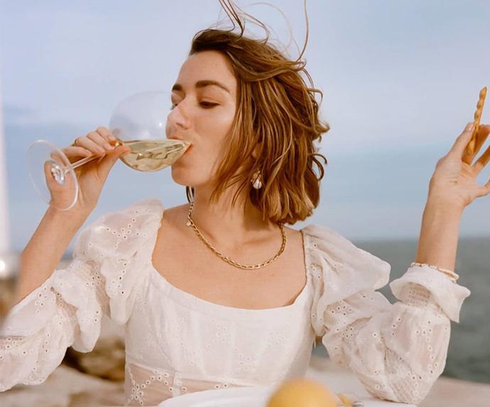 Carmen Grace Hamilton drinking white wine