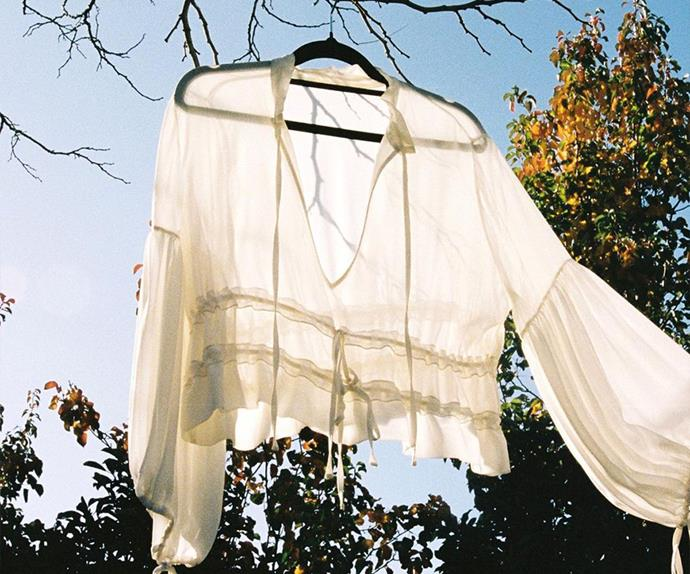 White shirt hanging from tree in the sun