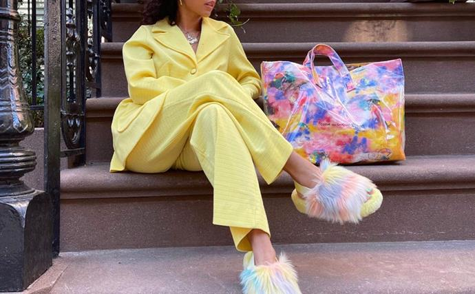 Girl in a yellow suit wearing fluffy ugg slides
