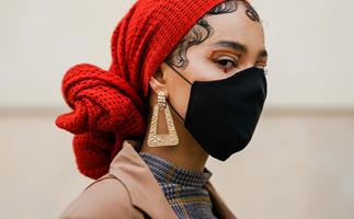 Woman wearing red headscarf and black face mask